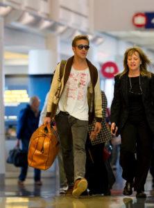 Ryan Gosling Carrying Luggage