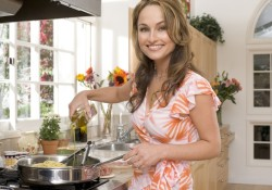 Giada De Laurentiis cooking spaghetti in the kitchen