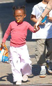 Zahara Jolie Pitt eats Cheetos