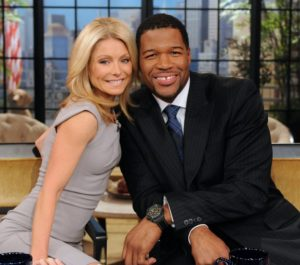 Kelly Ripa and Michael Strahan pose on the set of their show