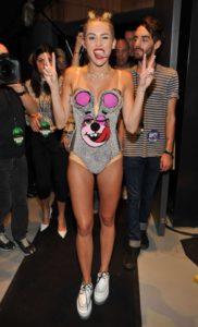 Miley Cyrus half naked