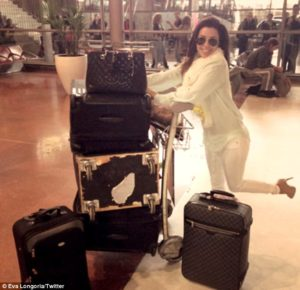 Eva Longoria with Suitcases