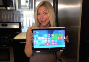 GiGi Dubois holds HP computer Meghan Trainor