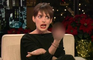 Anne Hathaway flipping the bird