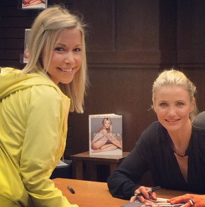 Cameron Diaz signs a copy of her book