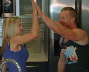 Brad Gouthro and GiGi Dubois high five